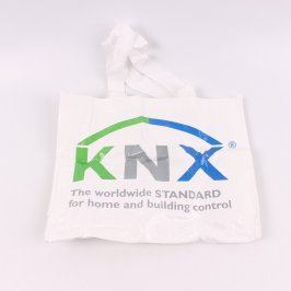 Bílá pevná taška s nápisem KNX.