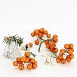 Vánoční dekorace: zvonečky a zlaté bobule