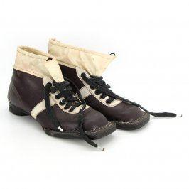 Staré kožené běžkařské boty černo bílé