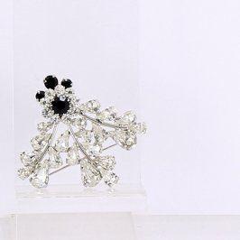 Brož tvořená bílými a černými kamínky