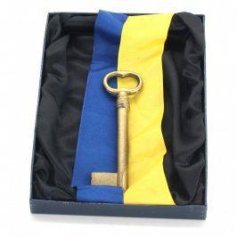 Dekorativní klíč v krabičce s erbem